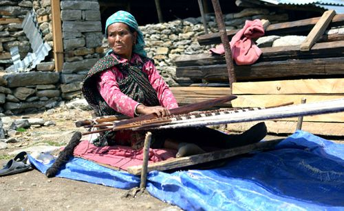 In Tipling, weaving their traditional costume.